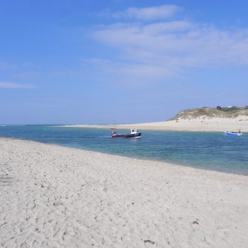 A boat on the estuary at Porthkidney beach